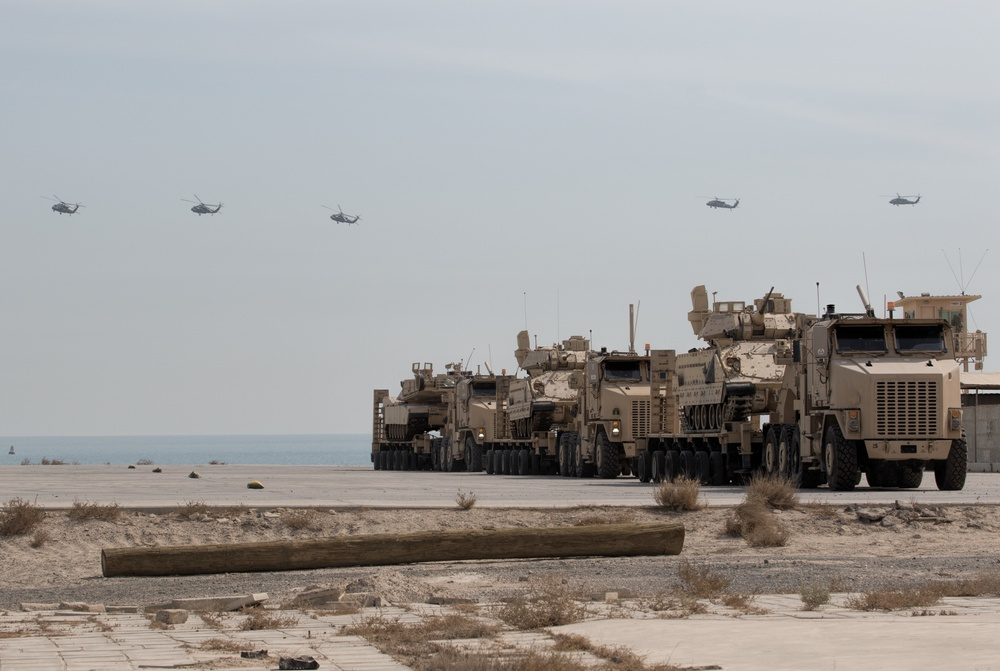 Black Hawks Fly Over Armored Vehicles