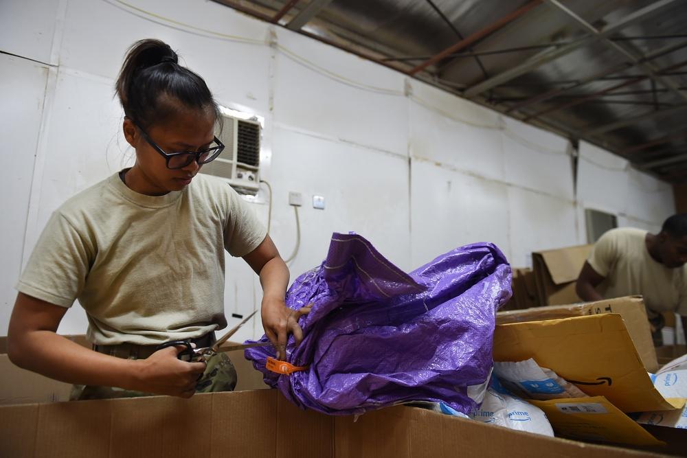 Airmen, Marines partners in postal
