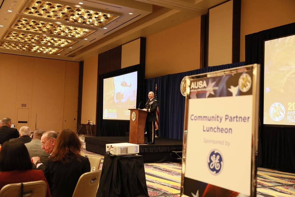 Perna addresses community partners