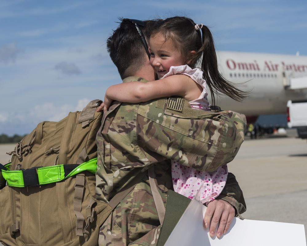 JBLE Airman return from frontline