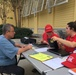 U.S. Army Corps of Engineers personnel help Florida residents sign up for Operation Blue Roof