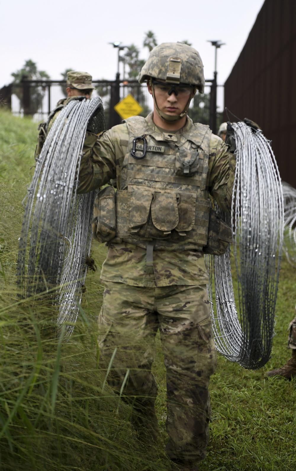 An Army Engineer Hauls Concertina Wiring