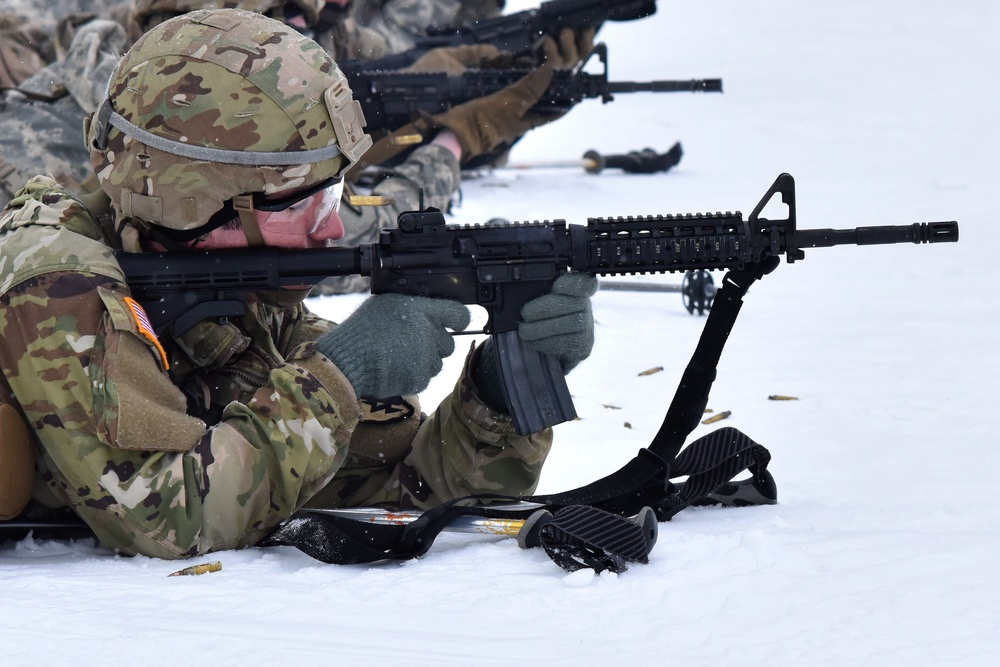 Soldier firing a M4 in the snow