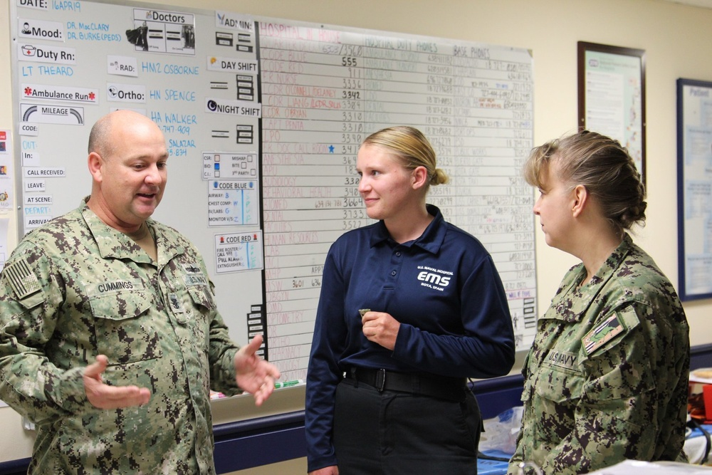 Command Triad explains Meritorious Advancement Program to Newly Promoted HM3 Gretchen Smith