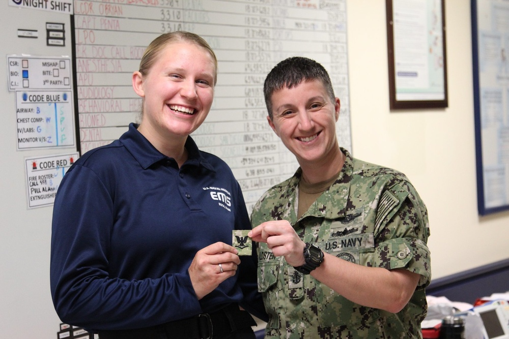 HM3 Gretchen receives her rank from Command Career Counselor, Chief Melissa Goldstein