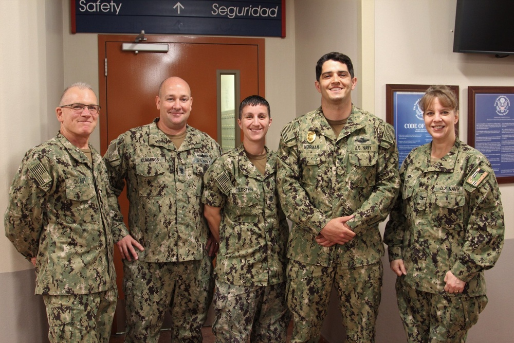 Newly Promoted HM1 Kasey Norman Stands With Command Triad and Career Counselor