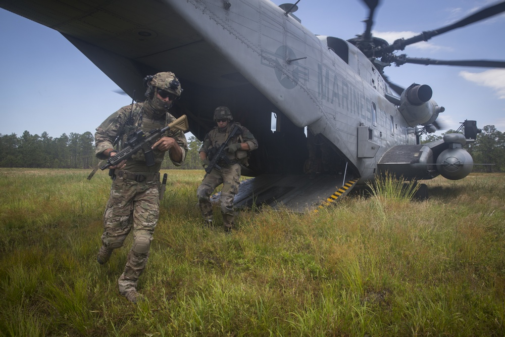 U.S. Marines and NATO allies conduct tactical recovery of aircraft personnel