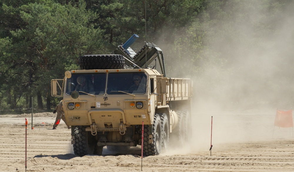 U.S. Army Engineers demonstrate American mine dispensing capabilities for the Polish army