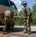 Soldiers prepare LMTV for towing