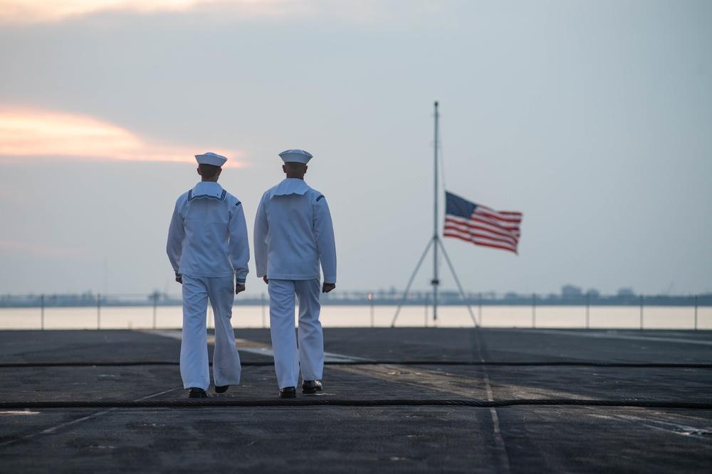 U.S. Sailors observe evening colors