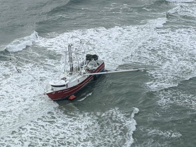 The Coast Guard hoisted four fishermen from an 88-foot fishing vessel in Browns Inlet, North Carolina.