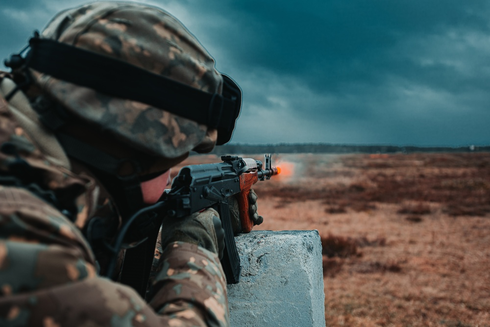 Romanian Soldiers conduct individual weapons qualification training