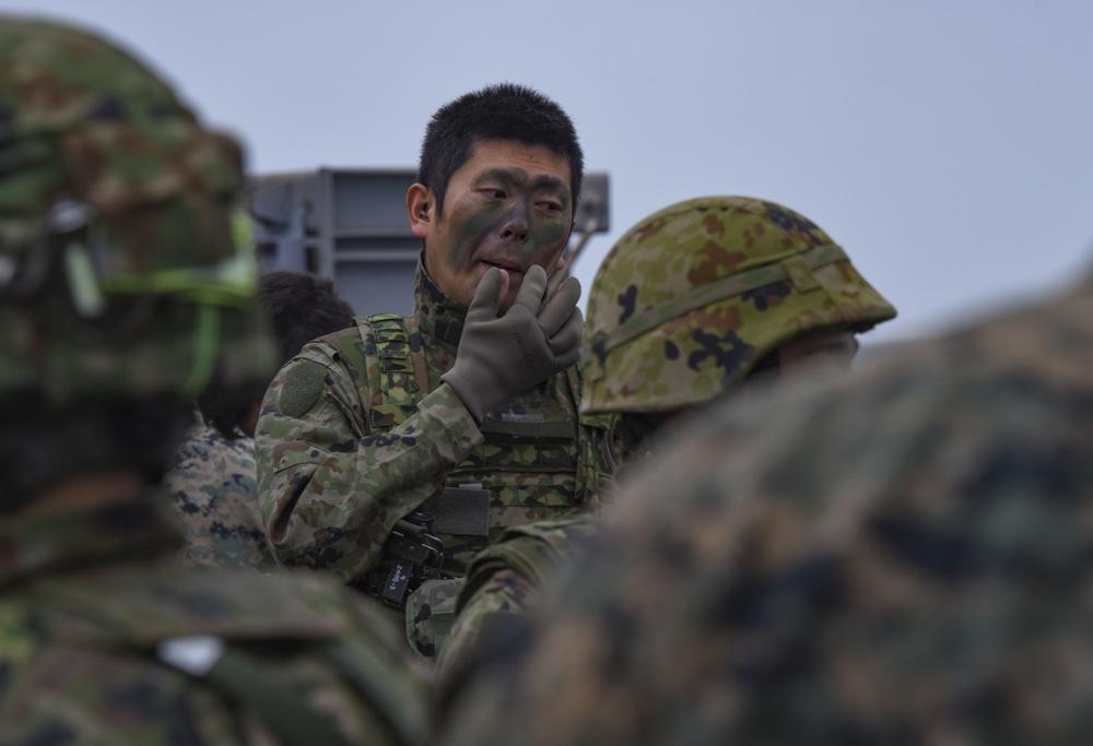 Japanese Soldier Applies Face Paint