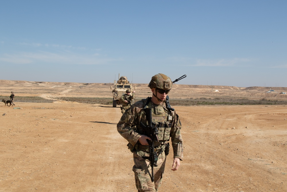25th Infantry Division Soldiers conduct a patrol around the perimeter of Al Asad Airbase