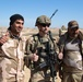 Iraqi and U.S. soldiers pose for a photograph along the perimeter of Al Asad Airbase