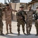 25th Infantry Division Soldiers take a photo with Iraqi troops