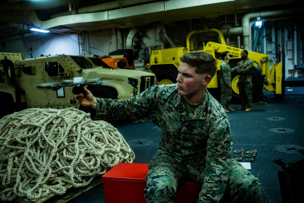 Marines with the 31st MEU conduct function checks on their Instant Eye drone system
