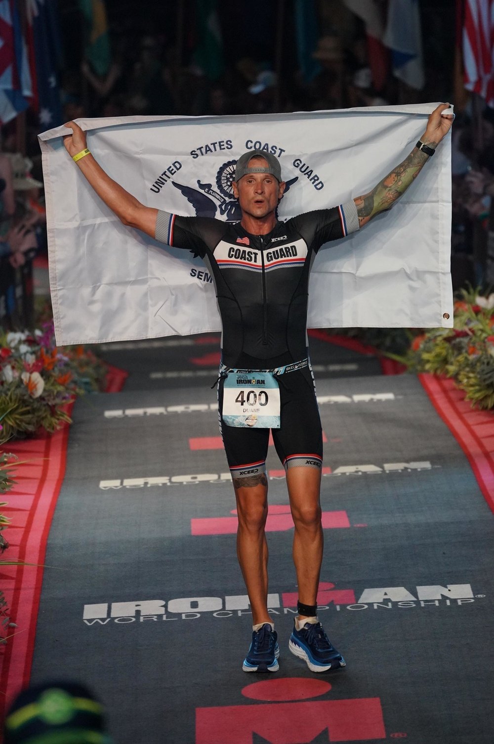 Lt. Duane Zitta crosses the finish line of the Ironman World Championships in Kona, Hawaii, Oct. 15, 2019. Zitta finished the race in 11 hours, 10 minutes, and 14 seconds. (U.S. Coast Guard photo by Lt. Duane Zitta/Released)