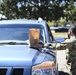 Cannon Airmen volunteer in helping families w/ medication drop off point