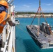 Sailors and Marines Offload EMF From USNS DAHL