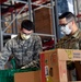 Air National Guardsmen assigned to the 149th Fighter Wing assist local food banks