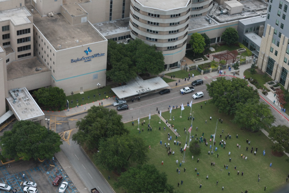 Fort Hood aviators salute Central Texas healthcare professionals with healthcare center overflights