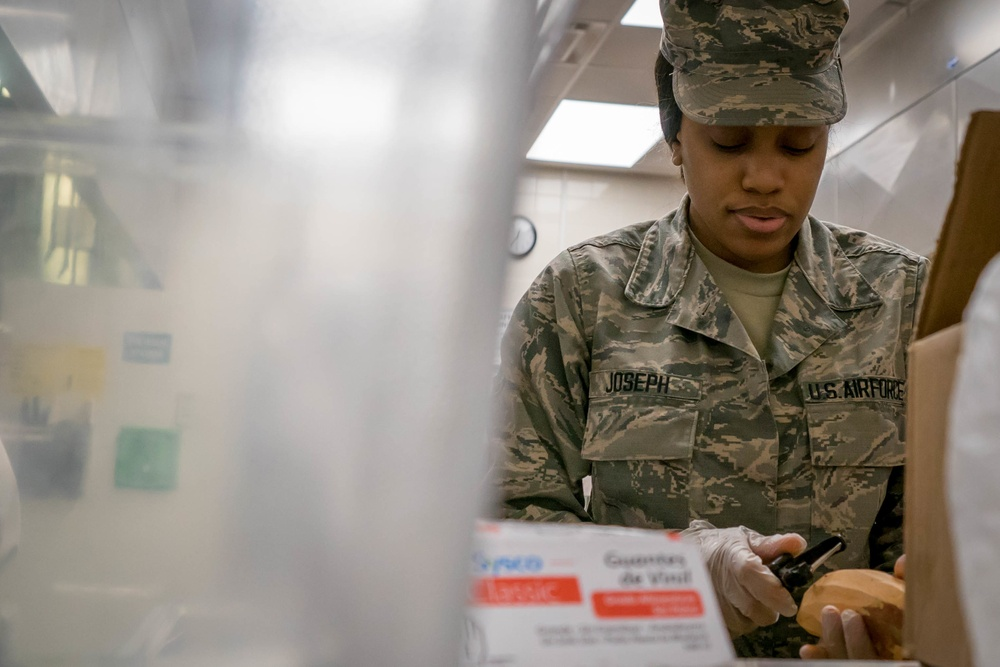 Services Airman Fills Plates and Spirits