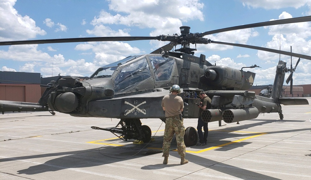 A Tobyhanna Army Depot electronics mechanic repairs the transponder on an AH-64D Apache Attack Helicopter