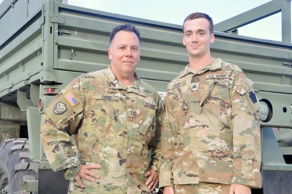 Father and son deployed together promoted