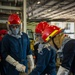 USS Carl Vinson (CVN 70) Sailors Particpate In Pipe Patching Drill