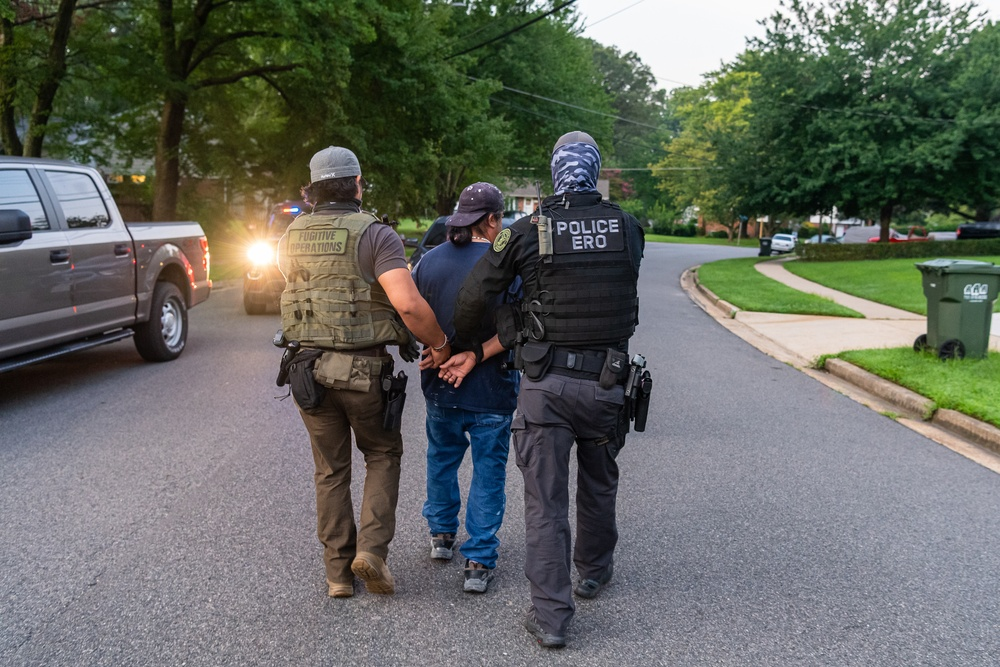ERO officers apprehend a criminal alien target in northern Virginia during a Cross Check operation.