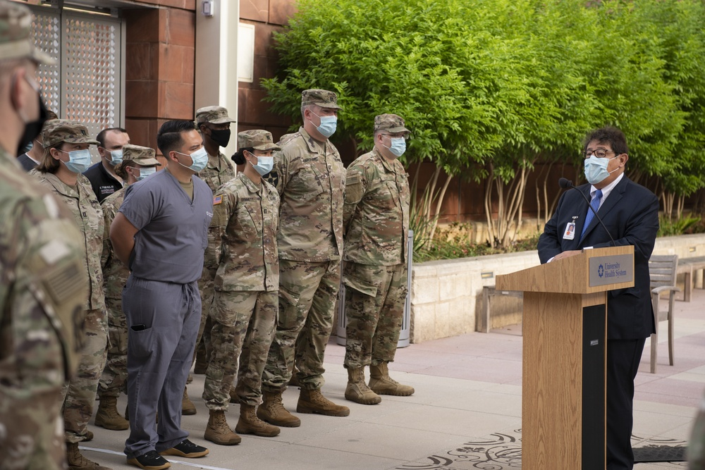Soldiers from the Urban Augmentation Medical Task Force - 627 meet with hospital staff from University Hospital