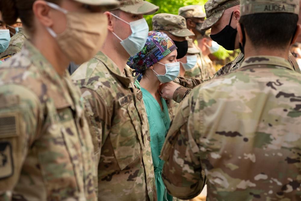 U.S. Army Lt. Col. Jason Hughes, commander, Urban Augmentation Medical Task Force - 627 presents awards at University Hospital