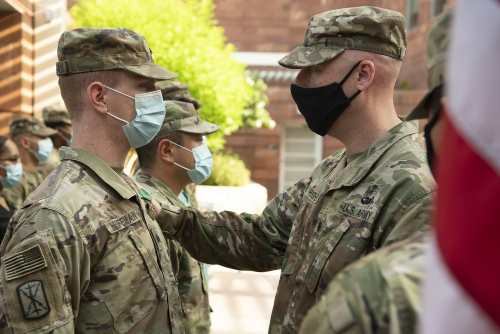 U.S. Army Lt. Col. Jason Hughes, Commander, Urban Augmentation Medical Task Force - 627 presents an award at University Hospital