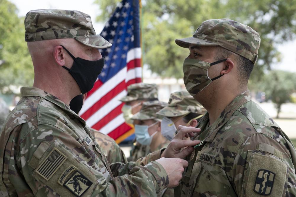 U.S. Army Lt. Col. Jason Hughes, Commander, Urban Augmentation Medical Task Force - 627 presents awards at Methodist Hospital Metropolitan