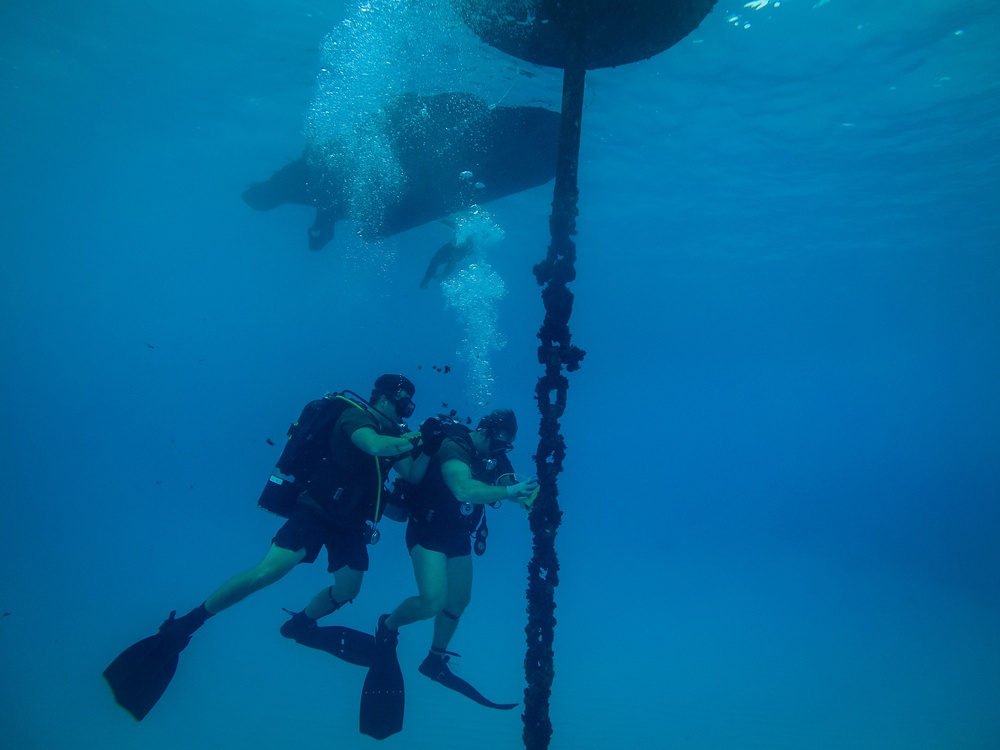 Navy Seabee Divers Inspect Pier in CNMI