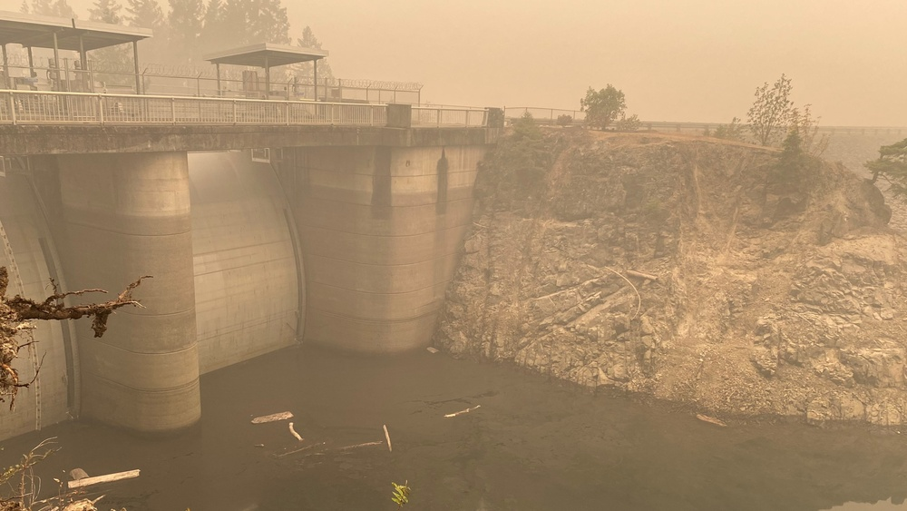 Smoke hangs heavy in the air around the Blue River Dam spillway Sept. 14, just days after the Holiday Farm Fire burned through the area, impacting Blue River and nearby Cougar Dam.