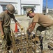 U.S. Navy Seabees continue construction of warehouse and maintenance buildings in support of NBU 7.