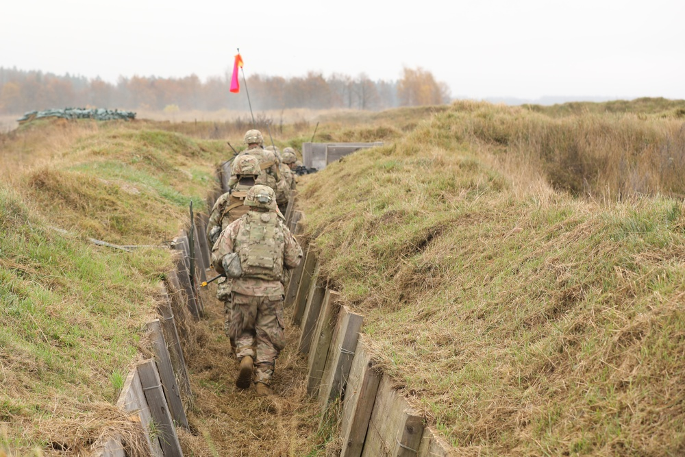 Troop Takes to the Trenches