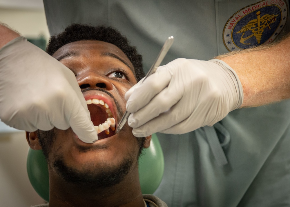 NMCSD OMFS Inspects Patient's Oral Cavity After Immediate Jaw Replacement Procedure