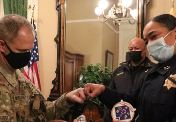 Cal Guard Col. Wooldridge trades challenge coins with CHP Commissioner Amanda Ray