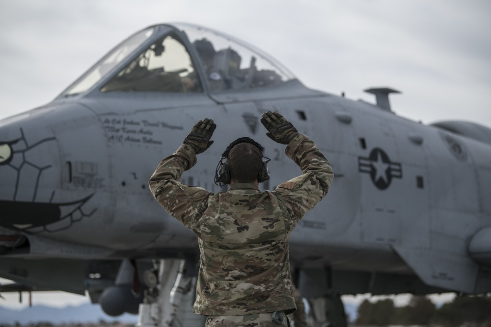 Airman signals A-10C pilot before flight at Red Flag 21-1