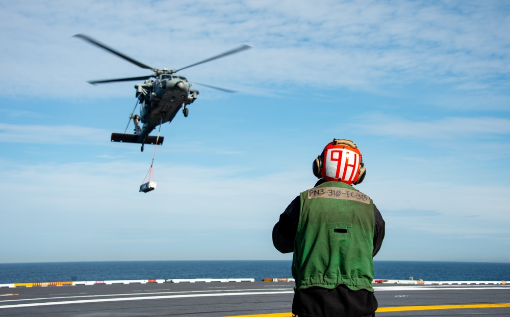 USS Carl Vinson (CVN 70) and Helicopter Sea Combat Squadron (HSC) 4 Conduct a Vertical Replenishment