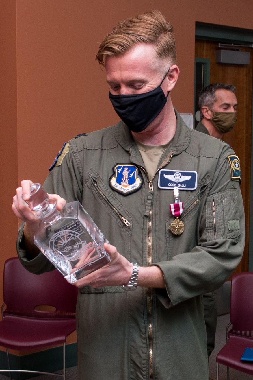 Lt. Col. Justin Galli receives parting gift at the 232nd Operations Squadron change of command
