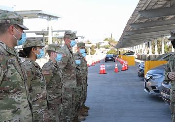 U.S. Army Col. Robert Wooldridge awards coins to Cal Guardsmen at Cal State LA vaccine site