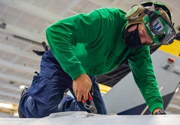 USS Carl Vinson (CVN 70) Sailors Perform Aircraft Maintenance