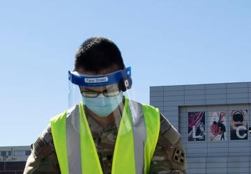 U.S. Army Spc. Bernstein Ragay Vaccinates a community member