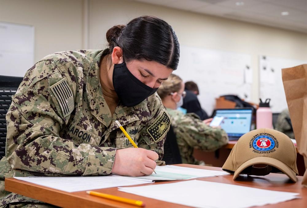 Local recruiters take the Navywide E-6 advancement exam