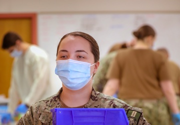 U.S. Navy Sailors conduct COVID-19 vaccinations at York College