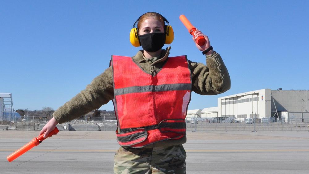 SrA Evans marshals an RC-135 Rivet Joint